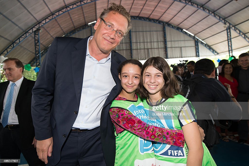 Secretary General Jerome Valcke poses for photo with kids during visit the FIFA 11 for Health Program as part of the 2014 FIFA World Cup Host City Tour on April 23, 2014 in Cuiaba, Brazil