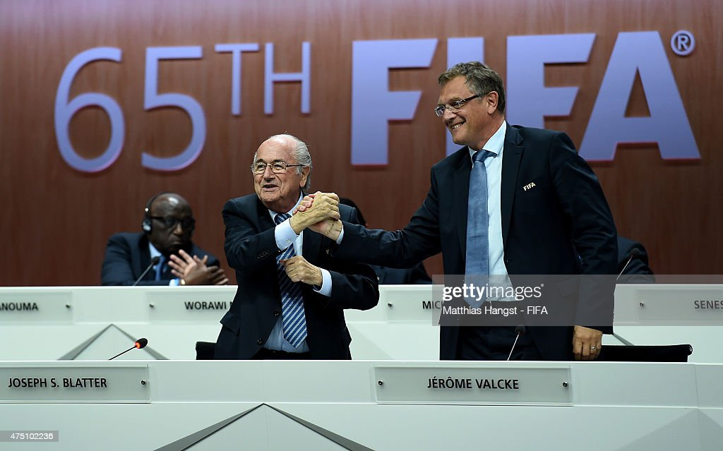 Secretary General Jerome Valcke (R) shakes hands with FIFA President Joseph S. Blatter during the 65th FIFA Congress at the Hallenstadion on May 29, 2015 in Zurich, Switzerland.