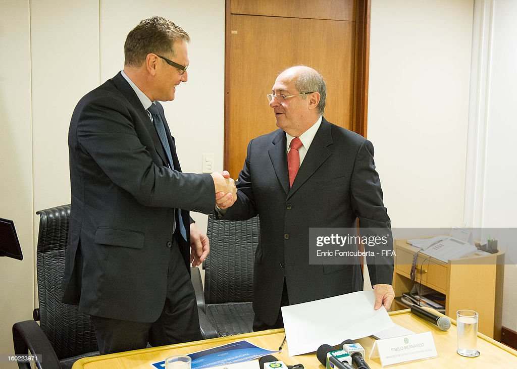 Secretary General Jerome Valckle (R) shakes hands with Brazilian Communications Minister Paulo Bernardo Silva after signing a Memorandum of Understanding, prior to a press conference at the Ministry of Communications building during the 2014 FIFA World Cup Host City Tour on January 28, 2013 in Brasilia, Brazil.