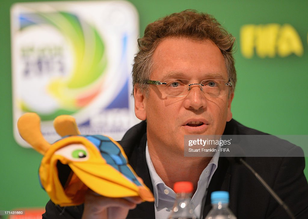 Secretary General, Jerome Valke holds a cap in the form of the mascot as he talks with the media during the FIFA media briefing and 2014 host city event at Maracana on June 24, 2013 in Rio de Janeiro, Brazil.