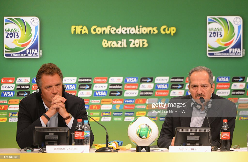 Secretary General, Jerome Valke ponders with Brazilain minister of sport Aldo Rebelo during the FIFA media briefing and 2014 host city event at Maracana on June 24, 2013 in Rio de Janeiro, Brazil.