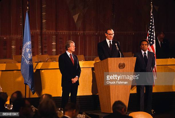 Secretary General Kurt Waldheim address the United Nations on the signing of the Human Rights Bill with American President Jimmy Carter standing on...