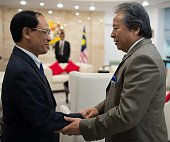 Secretary General Le luong Minh and Malaysian Foreign Minister Anifah Aman speak prior to a meeting at the foreign ministry in Putrajaya on January 7...