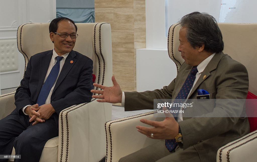 Secretary General Le luong Minh (L) and Malaysian Foreign Minister <a gi-track='captionPersonalityLinkClicked' href=/galleries/search?phrase=Anifah+Aman&family=editorial&specificpeople=5958202 ng-click='$event.stopPropagation()'>Anifah Aman</a> speak prior to a meeting at the foreign ministry in Putrajaya on January 7, 2015. Le luong Minh arrived for a two day working visit to mark the beginning of Malaysia's role as Chairman of Asean . AFP PHOTO / MOHD RASFAN