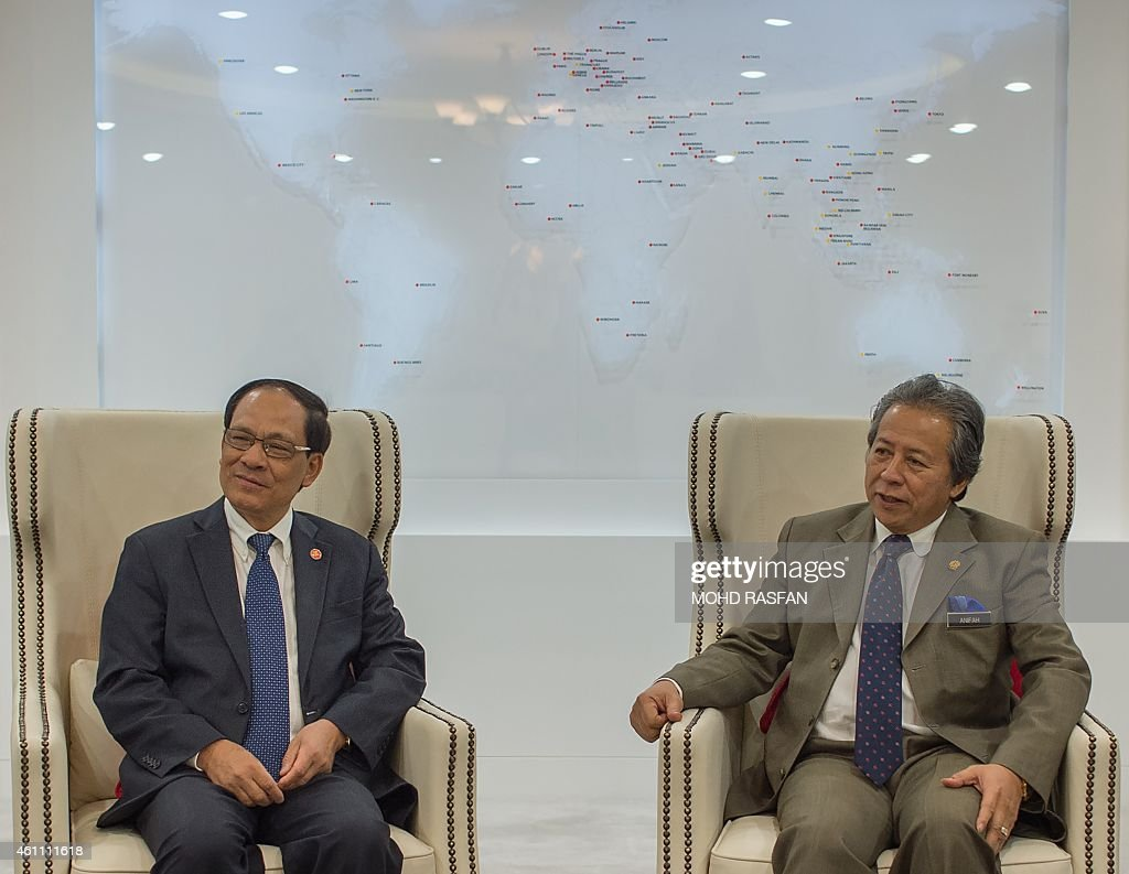 Secretary General Le luong Minh (L) and Malaysian Foreign Minister <a gi-track='captionPersonalityLinkClicked' href=/galleries/search?phrase=Anifah+Aman&family=editorial&specificpeople=5958202 ng-click='$event.stopPropagation()'>Anifah Aman</a> speak prior to a meeting at the foreign ministry in Putrajaya on January 7, 2015. Le luong Minh arrived for a two day working visit to mark the beginning of Malaysia's role as Chairman of Asean .