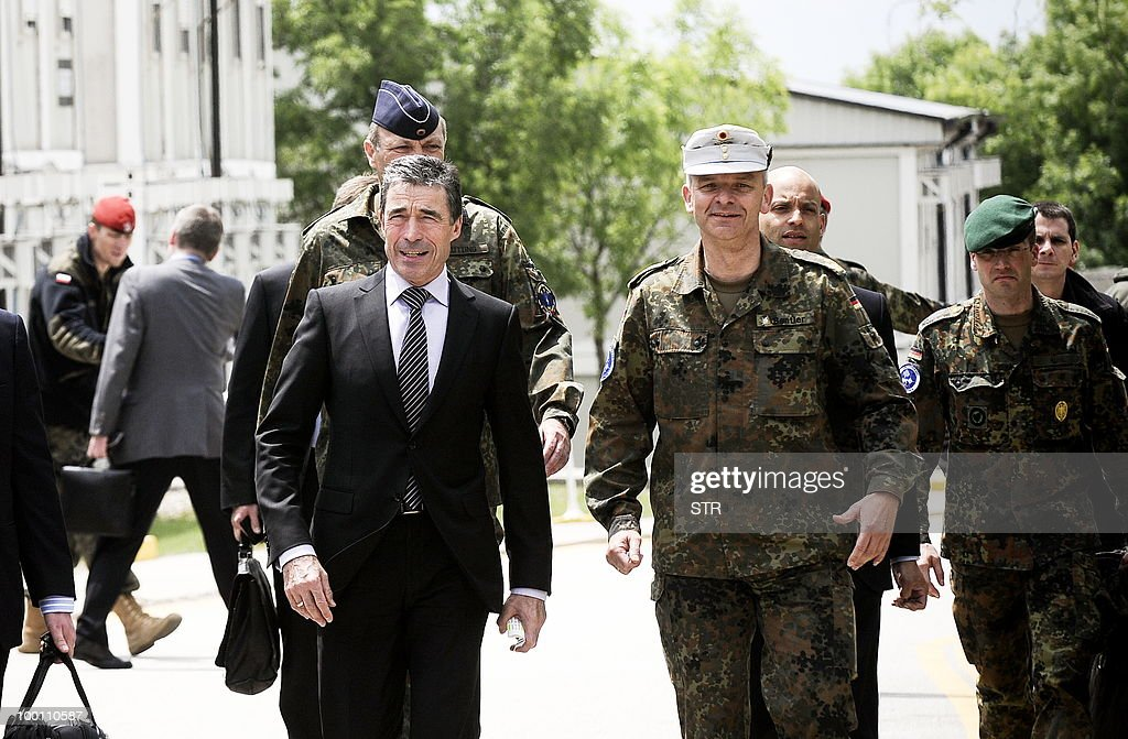 Secretary General Mr Anders Fogh Rasmussen,(L) flanked by KFOR Commander General Markus Bentler arrives for a press conference at the KFOR headquarters in Pristina on May 21, 2010.