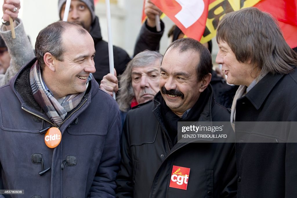 Secretary General of CFDT Laurent Berger speaks with newly elected CGT (General Confederation of Labour) Secretary General <a gi-track='captionPersonalityLinkClicked' href=/galleries/search?phrase=Philippe+Martinez&family=editorial&specificpeople=662194 ng-click='$event.stopPropagation()'>Philippe Martinez</a> and his predecessor <a gi-track='captionPersonalityLinkClicked' href=/galleries/search?phrase=Bernard+Thibault&family=editorial&specificpeople=658517 ng-click='$event.stopPropagation()'>Bernard Thibault</a> as they take part in a demonstration during a global day of action to defend the right to strike, on February 18, 2015 in Paris. French Economy Minister Emmanuel Macron is trying to push through a controversial series of laws that he hopes will, in his words, 'unblock' France's economy, which is suffering from high unemployment and sluggish growth. AFP PHOTO / KENZO TRIBOUILLARD