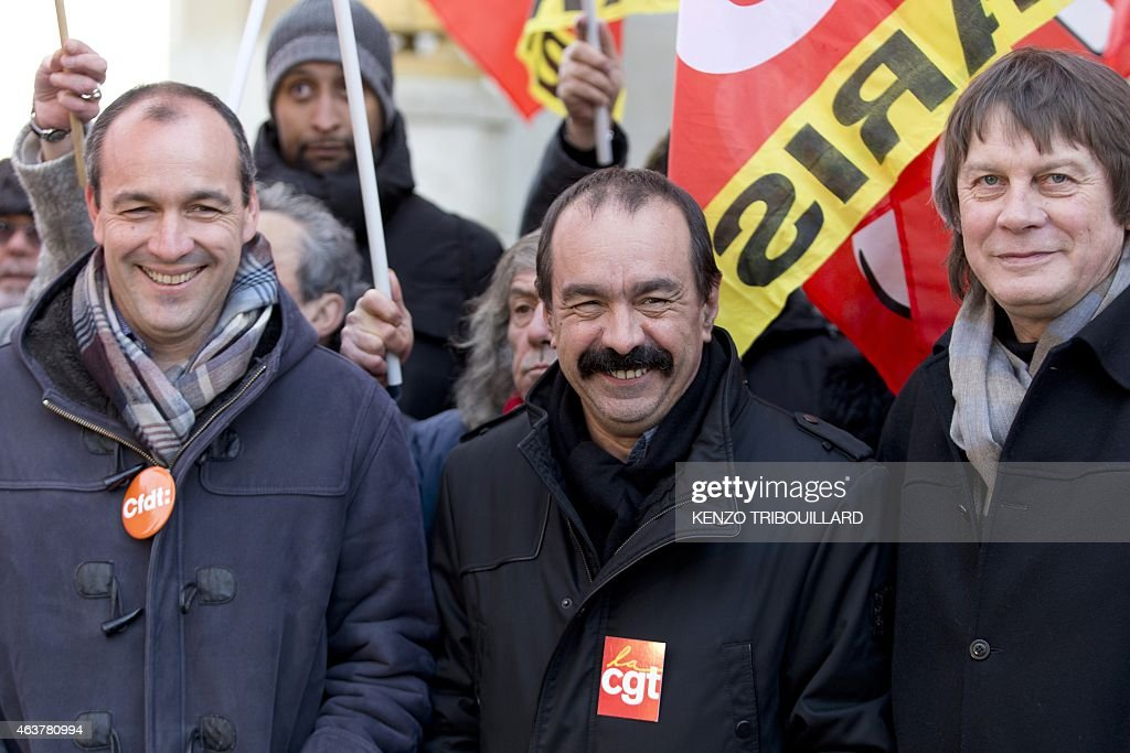 Secretary General of CFDT Laurent Berger stands with newly elected CGT (General Confederation of Labour) Secretary General <a gi-track='captionPersonalityLinkClicked' href=/galleries/search?phrase=Philippe+Martinez&family=editorial&specificpeople=662194 ng-click='$event.stopPropagation()'>Philippe Martinez</a> and his predecessor <a gi-track='captionPersonalityLinkClicked' href=/galleries/search?phrase=Bernard+Thibault&family=editorial&specificpeople=658517 ng-click='$event.stopPropagation()'>Bernard Thibault</a> during a demonstration during a global day of action to defend the right to strike, on February 18, 2015 in Paris. French Economy Minister Emmanuel Macron is trying to push through a controversial series of laws that he hopes will, in his words, 'unblock' France's economy, which is suffering from high unemployment and sluggish growth.
