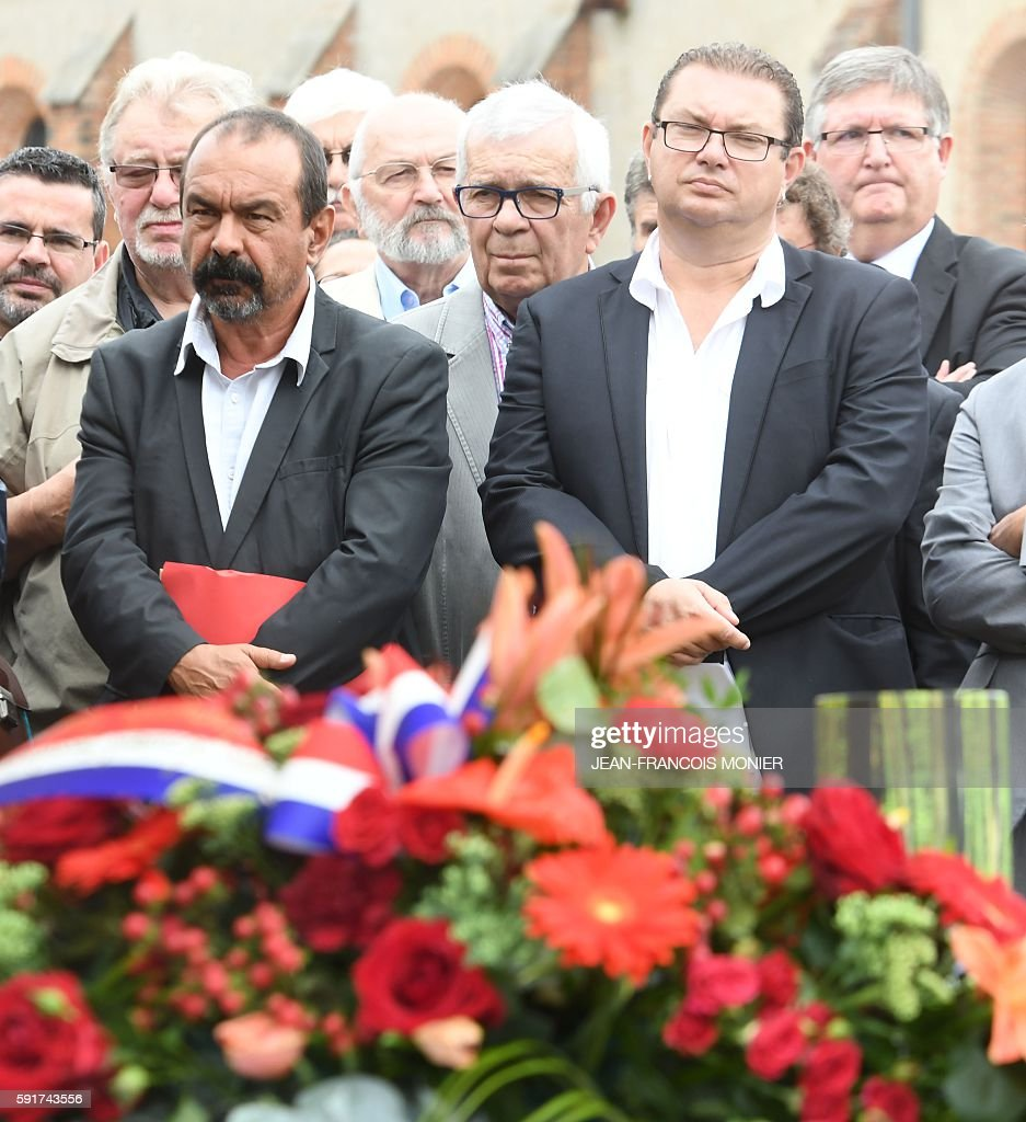 Secretary general of French major union CGT Philippe Martinez and secretary general of the CGT railway Gregory Roux pay honor to Georges Seguy former...