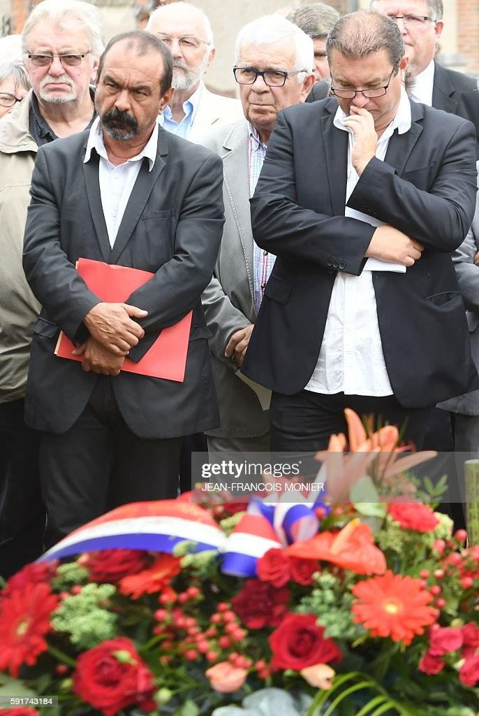 Secretary general of French major union CGT Philippe Martinez pays honor to Georges Seguy former secretary general of the CGT during his funeral at...