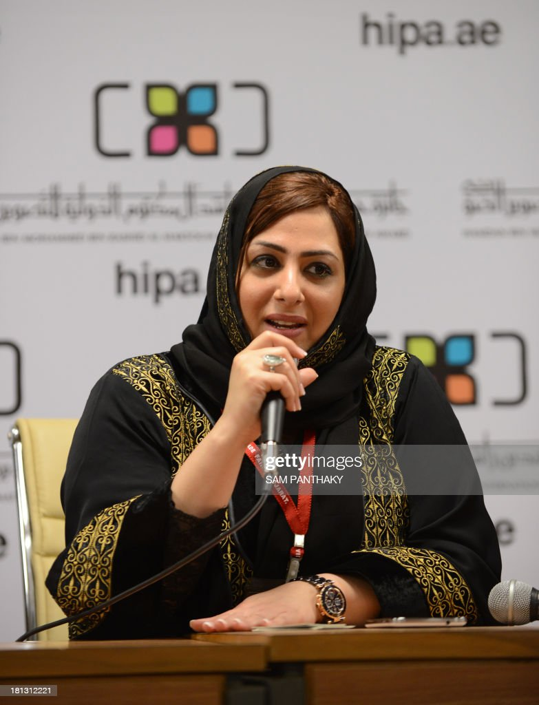 Secretary General of Hamdan Bin Mohammed Bin Rashid Al Maktoum International Photography Award (HIPA), Sahar Mohammed Al-Zarei, interact during the first day of India Photo Video Trade Fair in Ahmedabad on September 20, 2013. The HIPA delegates were here as a part of a global tour taking Dubai's vision of photography around the world. Founded in 2011 the award is set have a grand prize of USD 120,000 and an overall prize pool of USD 389,000. AFP PHOTO/ Sam PANTHAKY