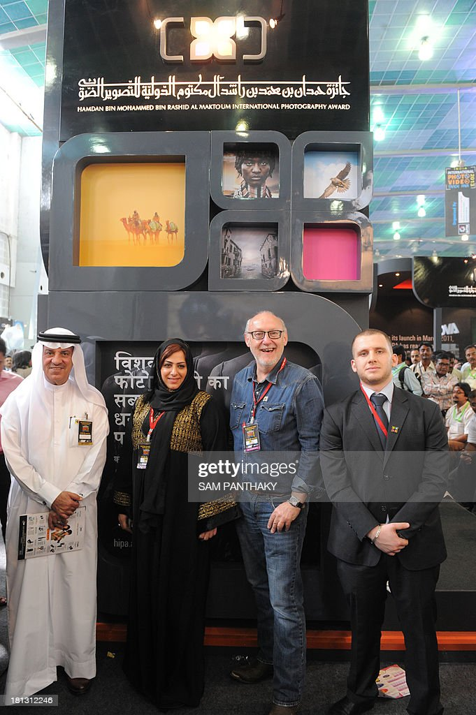 Secretary General of Hamdan Bin Mohammed Bin Rashid Al Maktoum International Photography Award (HIPA) Sahar Mohammed Al-Zarei (2L), photographer and HIPA judge, Martin Grahame-Dunn (2R), Consulate General of the United Arab Emirates in Mumbai, Mohammed Yousuf M. Al Awadhi (L) and English Editor of HIPA, Ziad Hosam Al Sama (R), pose for a photo on the first day of India Photo Video Trade Fair in Ahmedabad on September 20, 2013. The HIPA delegates were here as a part of a global tour taking Dubai's vision of photography around the world. Founded in 2011 the award is set have a grand prize of USD 120,000 and an overall prize pool of USD 389,000. AFP PHOTO / Sam PANTHAKY