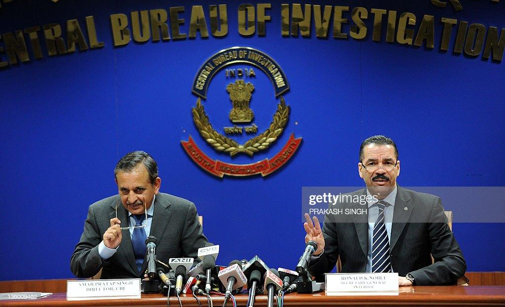 Secretary General of Interpol Mr Ronald K Noble gestures as Central Bureau of Investigation Director Amar Pratap Singh looks on during a press...
