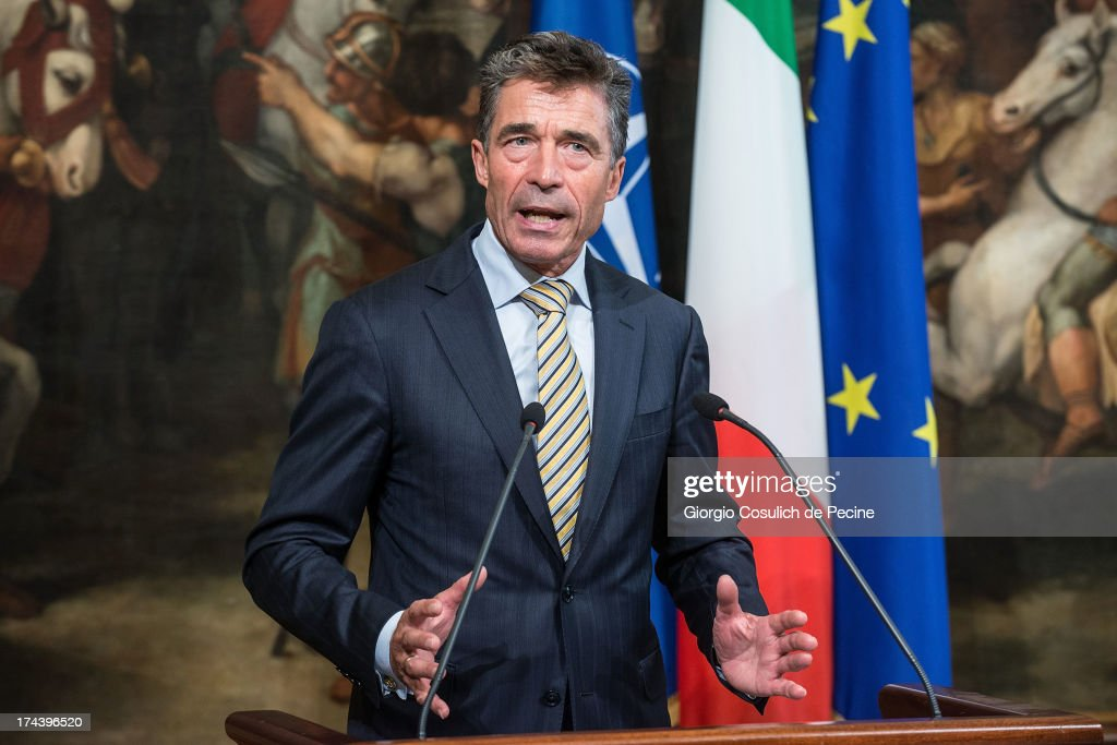 Secretary General of NATO <a gi-track='captionPersonalityLinkClicked' href=/galleries/search?phrase=Anders+Fogh+Rasmussen&family=editorial&specificpeople=549374 ng-click='$event.stopPropagation()'>Anders Fogh Rasmussen</a> gestures as he attends a press conference with Italian Prime Minister Enrico Letta (not in picture) at Palazzo Chigi on July 25, 2013 in Rome, Italy. During the press conference the Prime Minister Enrico Letta announced that he will travel to Afghanistan on August 12 to visit the Italian troops.