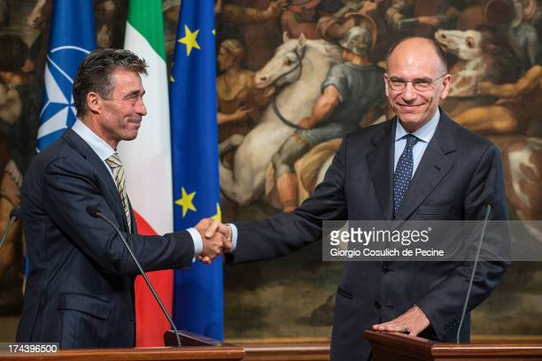 Secretary General of NATO Anders Fogh Rasmussen shakes hands with Italian Prime Minister Enrico Letta after a press conference at Palazzo Chigi on...
