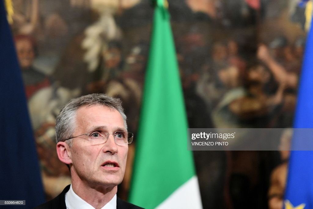 Secretary General of NATO Jens Stoltenberg speaks during a joint press conference with Italian Prime Minister Matteo Renzi following their meeting on May 24, 2016 at the Palazzo Chigi in Rome. / AFP / VINCENZO