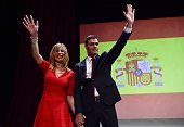 Secretary general of Spanish Socialist Party Pedro Sanchez and his wife Begona Fernandez wave after delivering a speech during his official...
