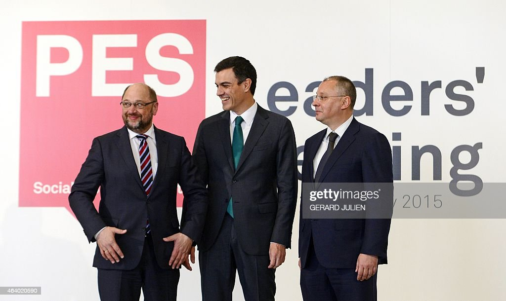 Secretary general of Spanish Socialist Party (PSOE) <a gi-track='captionPersonalityLinkClicked' href=/galleries/search?phrase=Pedro+S%C3%A1nchez+-+Spanish+Politician&family=editorial&specificpeople=13409003 ng-click='$event.stopPropagation()'>Pedro Sánchez</a> (C) smiles at European Parliament President <a gi-track='captionPersonalityLinkClicked' href=/galleries/search?phrase=Martin+Schulz&family=editorial&specificpeople=598638 ng-click='$event.stopPropagation()'>Martin Schulz</a> (L) next to President of the Party of European Socialists (PES) Sergei Stanishev during the PES leaders meeting at IFEMA pavilion in Madrid, on February 21, 2015. The meeting, hosted by the Spanish Socialist Workers' Party (PSOE), gathers PES leaders, Prime Ministers and EU Commissioners who will discuss pivotal issues such as the fight against extremism and will make a joint declaration that will outline the PES roadmap for creating more and fairer jobs.