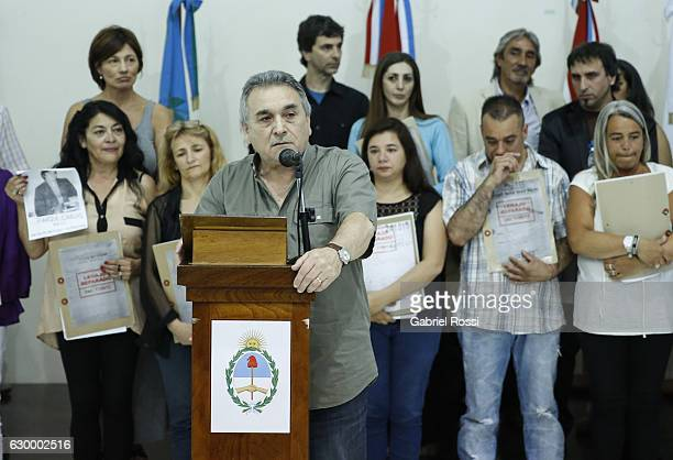 Secretary General of the CGT Juan Carlos Schmid speaks during the delivery of repaired files to the descendants of 20 disappeared railway workers at...