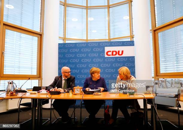 Secretary General of the Christian Democratic Union party Peter Tauber German Chancellor Angela Merkel and Christian Democratic Union partys...