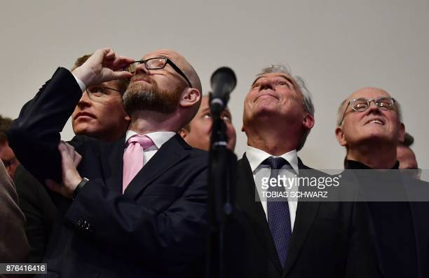 Secretary general of the Christian Democratic Union party Peter Michael Tauber looks up as they wait for German Chancellor and leader of the CDUparty...