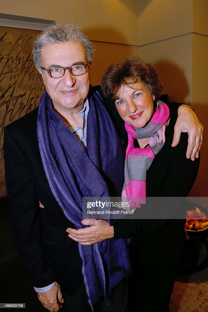 Secretary General of the French cinematheque Serge Toubiana and his wife pose backstage following the show of impersonator Laurent Gerra 'Un spectacle Normal' at L'Olympia on December 20, 2013 in Paris, France.
