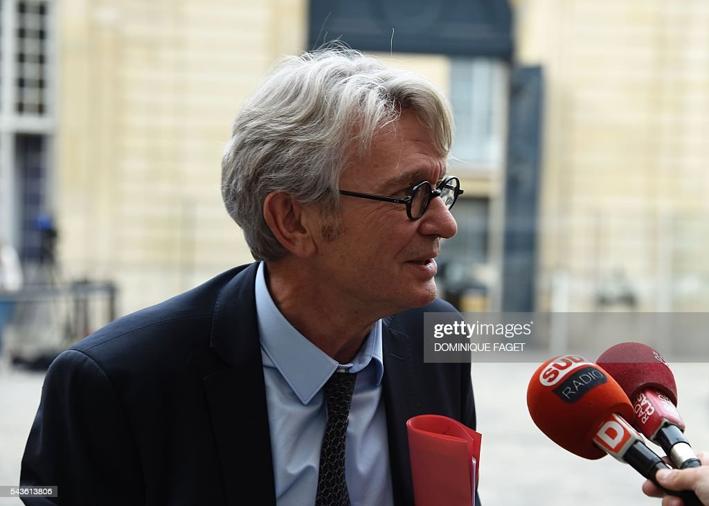 Secretary General of the French worker's union Force Ouvriere (FO), Jean-Claude Mailly answers journalists' questions as he arrives at the Hotel Matignon in Paris on June 29, 2016 before a meeting on the Socialist government's labour reforms with French Prime minister and French Labour minister. / AFP / DOMINIQUE