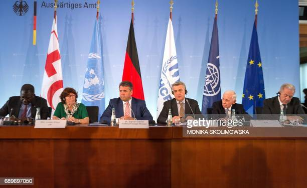Secretary General of the International Federation of Red Cross and Red Crescent Societies Elhadj As Sy UN representative for migration Louise Arbour...