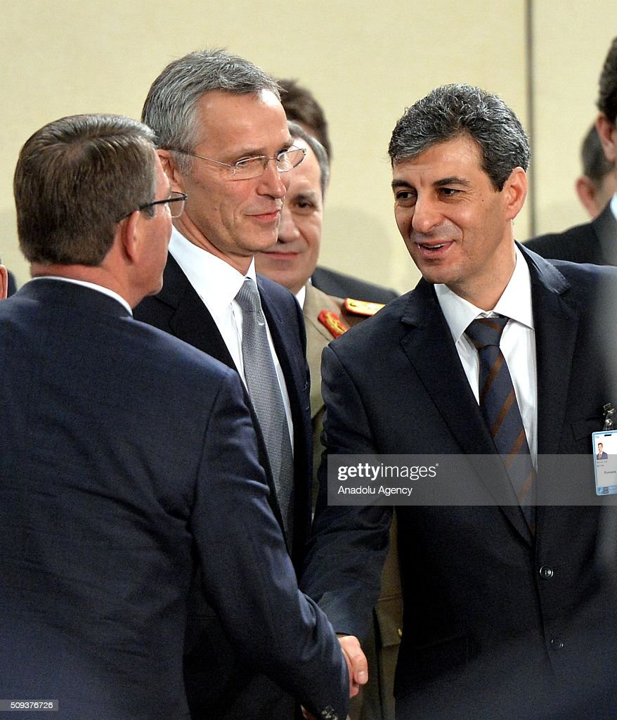 Secretary General of the North Atlantic Treaty Organization (NATO) Jens Stoltenberg (C) and Romanian Defense Minister Mihnea Loan Motoc (R) speak to each other prior to the start of a NATO Defence Ministers meeting at the NATO headquarter in Brussels, Belgium on February 10, 2016.