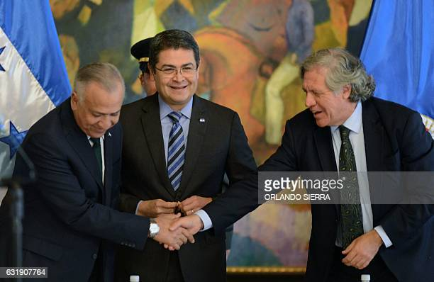 Secretary General of the Organization of American States Luis Almagro shakes hands with the President of the Honduran Congress Mauricio Oliva next to...