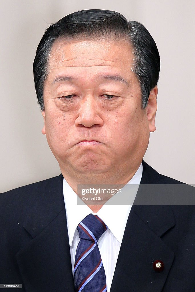 Secretary General of the ruling Democratic Party of Japan (DPJ) <a gi-track='captionPersonalityLinkClicked' href=/galleries/search?phrase=Ichiro+Ozawa&family=editorial&specificpeople=680192 ng-click='$event.stopPropagation()'>Ichiro Ozawa</a> reacts as he speaks during the party's annual convention at Hibiya Kokaido on January 16, 2010 in Tokyo, Japan. Ozawa's former secretary Tomohiro Ishikawa was arrested on January 15 for political funds scandals involving Ozawa's fund management body.