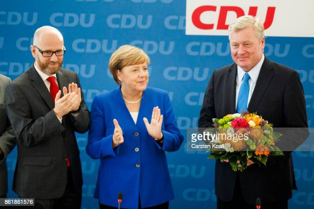 CDU secretary general Peter Tauber German Chancellor and leader of the German Christian Democrats Angela Merkel and CDU lead candidate in yesterday's...
