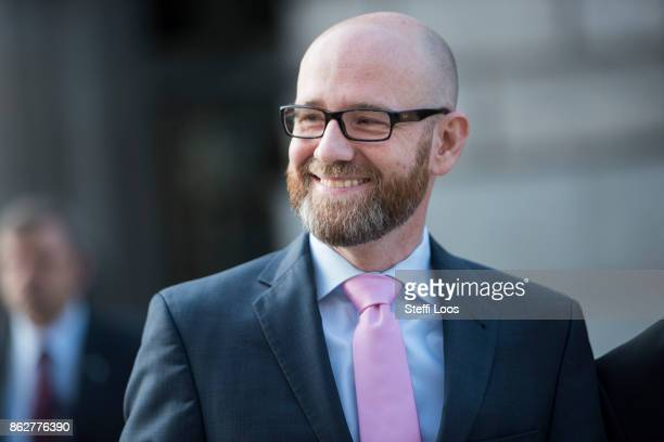 CDU secretary general Peter Tauber smiles on the first official day of talks on the formation of a new German government coalition on October 18 2017...