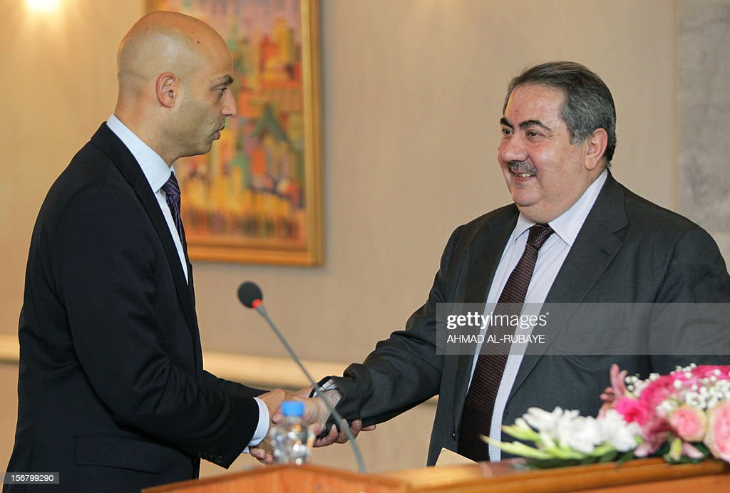 NATO secretary general's special representative for the Caucasus and Central Asia James Appathurai (L), shakes hands with Iraqi Foreign Minister Hoshyar Zebari, after a press conference in Baghdad on November 21, 2012.