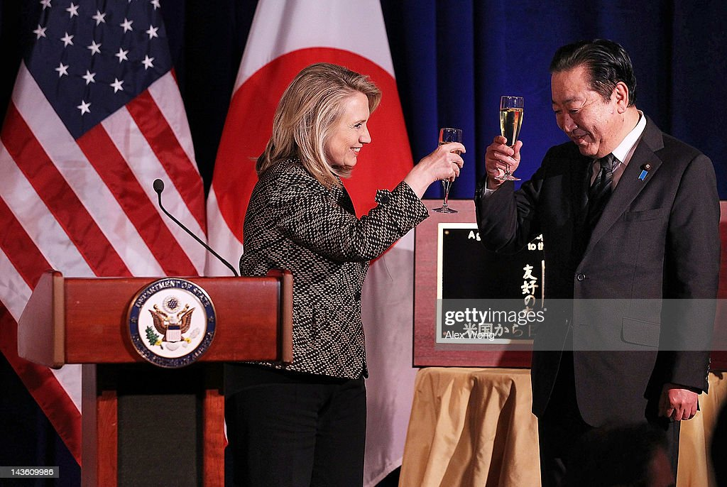 U.S. Secretary Hillary Rodham Clinton (L) toasts with Japanese Prime Minister <a gi-track='captionPersonalityLinkClicked' href=/galleries/search?phrase=Yoshihiko+Noda&family=editorial&specificpeople=6441440 ng-click='$event.stopPropagation()'>Yoshihiko Noda</a> (R) as Clinton hosts a dinner for Noda at National Geographic April 30, 2012 in Washington, D.C. Noda had met with President Obama for talks at the White House earlier.