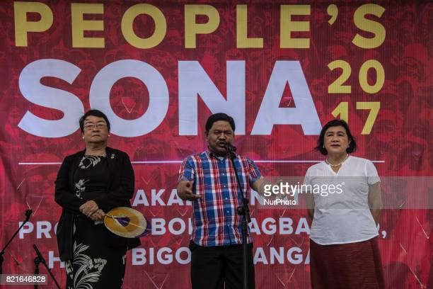 Secretary Judy M Taguiwalo Rafael Mariano and Secretary Liza Maza join the protesters President Duterte delivers his second State of the Nation...