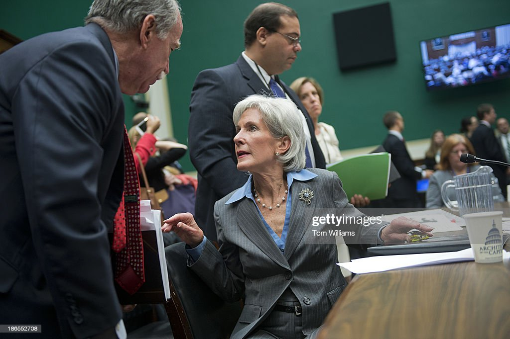 HHS Secretary Kathleen Sebelius talks with and aide after testifying before a House Energy and Commerce Committee hearing in Rayburn Building on the failures of Affordable Care Act's enrollment website.