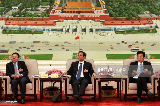 CPC secretary Liu Qi Beijing mayor Guo Jinlong and Zhu Jimin attend a meeting in the Great Hall of the People on March 6 2012 in Beijing China Known...