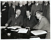 Secretary of Commerce Daniel Roper John D Biggers Administrator and Secretary of Agriculture Henry Wallace at a conference in the White House