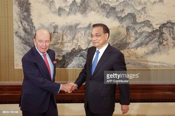 US Secretary of Commerce Wilbur Ross is welcomed by Chinese Premier Li Keqiang at the Zhongnanhai state guesthouse in Beijing on September 25 2017 /...