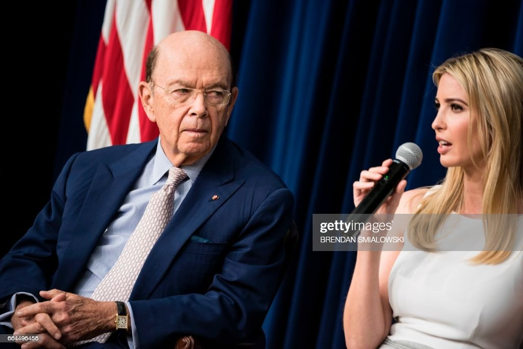 US Secretary of Commerce Wilbur Ross (L) listens while US First daughter Ivanka Trump speaks during a forum with Chief Executive Officers on the White House Campus April 4, 2017 in Washington, DC. / AFP PHOTO / Brendan Smialowski