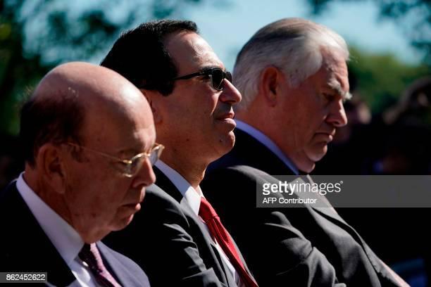 Secretary of commerce Wilbur Ross Secretary of the Treasury Steven Mnuchin and Secretary of State Rex Tillerson listen to the US President and...