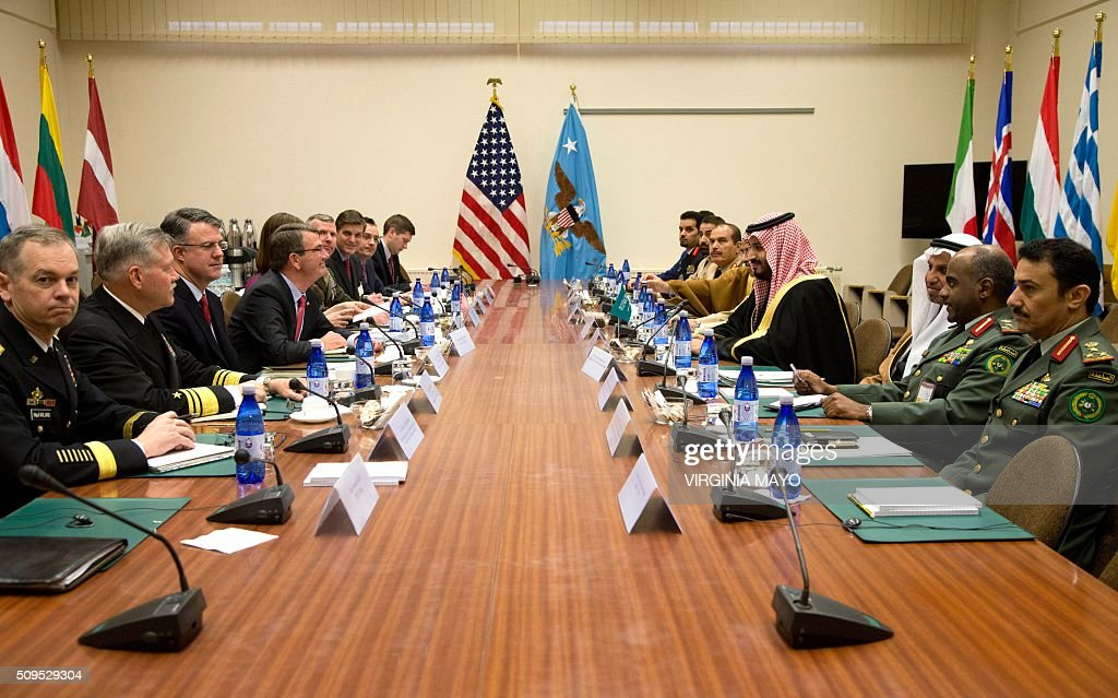 US Secretary of Defence Ash Carter (4th L) meets with Saudi Arabia's Defence Minister Mohammed bin Salman (4th R) on the sidelines of a meeting of NATO defence ministers at the NATO headquarters in Brussels, February 11, 2016. / AFP / POOL / Virginia Mayo