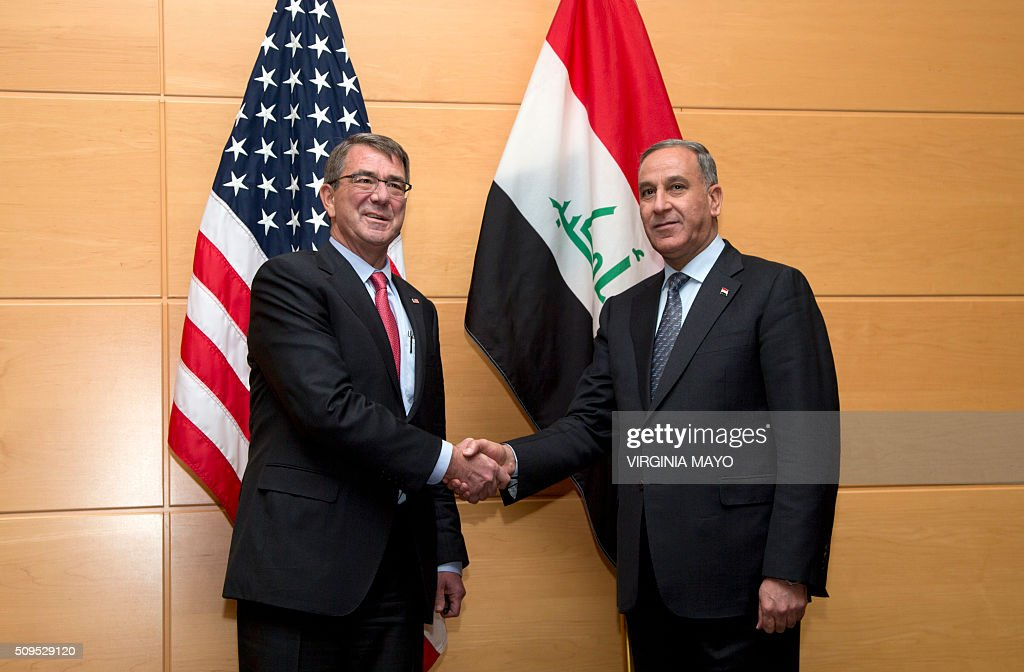 US Secretary of Defence Ash Carter (L) shakes hands with Iraqi Defence Minister Khaled al-Obeidi prior to a bilateral meeting on the sidelines of a meeting of NATO defence ministers at the NATO headquarters in Brussels, February 11, 2016. / AFP / POOL / Virginia Mayo