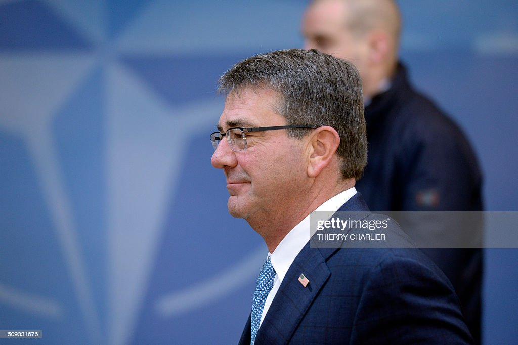 US Secretary of Defence Ashton Carter arrives to attend a meeting of the North Atlantic Council (NAC) of Defence Ministers at the NATO headquarters in Brussels, February 10, 2016. NATO defence ministers begin the two-day meeting to discuss issues including Turkey's request for help to deal with the migration crisis, the alliance's beefed up response to a more assertive Russia and the security threat posed by the Syria war. / AFP / THIERRY CHARLIER