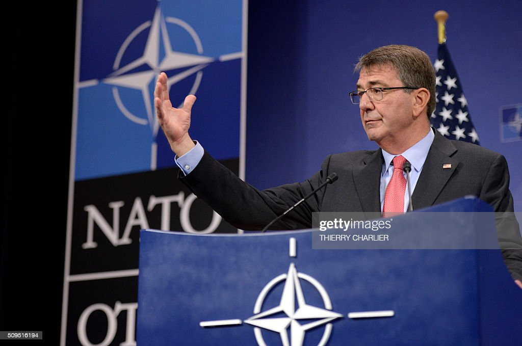 US Secretary of Defence Ashton Carter gestures as he addresses the media during the North Atlantic Council (NAC) of Defence Ministers' meeting at the NATO headquarter in Brussels on February 11, 2016. / AFP / THIERRY CHARLIER
