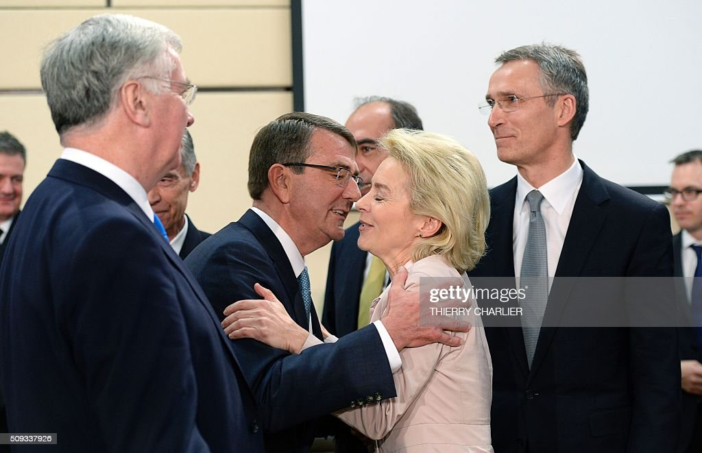 US Secretary of Defence Ashton Carter (L) greets German Defence Minister Ursula von der Leyen (C) beside Nato Secretary General Jens Stoltenberg (R) prior to a meeting of the North Atlantic Council (NAC) of Defence Ministers at the NATO headquarters in Brussels, February 10, 2016. NATO defence ministers convene a two-day meeting to discuss current defense issues and whether the Alliance should take a more direct role in dealing with its gravest migrant crisis since Worl War II. / AFP / THIERRY CHARLIER