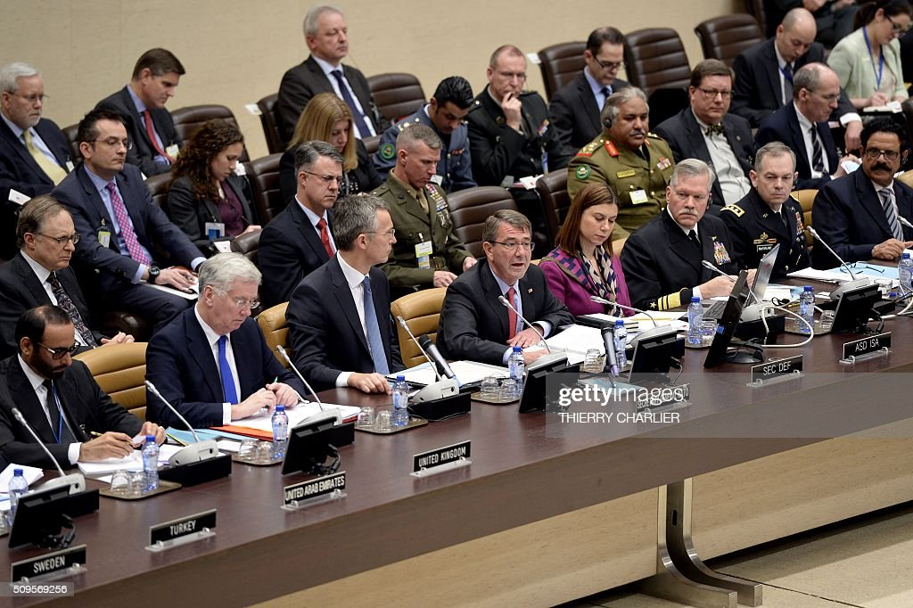 US Secretary of Defence Ashton Carter (C) speaks as British Defence Minister Michael Fallon (2-L) and NATO Secretary General Jens Stoltenberg (3-L) look on during the Global Coalition meeting against the Islamic State group IS held at NATO headquarter in Brussels on February 11, 2016. / AFP / THIERRY CHARLIER