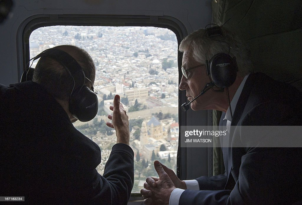 US Secretary of Defence Chuck Hagel (R) and his Israeli counterpart Moshe Yaalon look out of the window at the Old City of Jerusalem during a helicopter tour on April 22, 2013. Hagel met with Yaalon to put the finishing touches on a major arms deal and for talks on Syria's civil war and the Iranian nuclear threat.