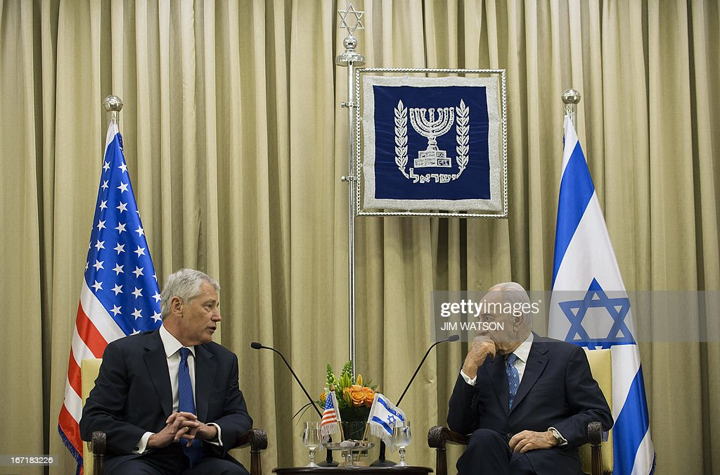 US Secretary of Defence Chuck Hagel (L) meets with Israeli President Shimon Peres at the President's office in Jerusalem on April 22, 2013. Hagel arrived in Israel at the start of a six-day regional tour, his first since taking over as Pentagon chief two months ago, which was likely to be dominated by concerns over Iran's nuclear programme and Syria's civil war. AFP PHOTO/POOL/JIM WATSON